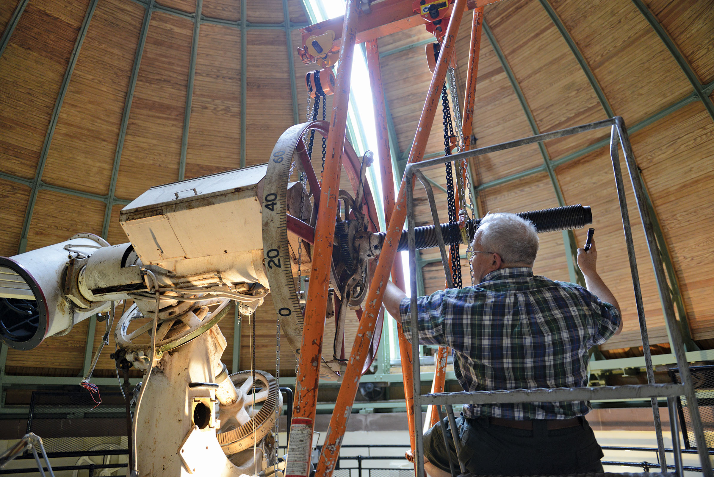 Engineer Fred Orthlieb, a specialist in antique telescope restoration, works on the nearly century-old refractor telescope. Photography by Olivia Drake MALS '08.