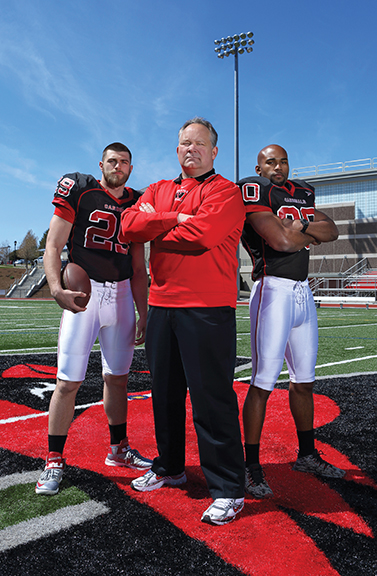 Coach Mike Whalen '83 and his players, (left) tight end Jonathan Day '15, and (right) wide receiver Jay Fabien '15.