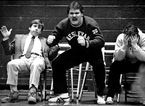 In this photo from his undergraduate days, wrestler Mike Whalen '83 is fierce in encouraging his teammates; Coach John Biddiscombe (left) displays a calmer demeanor.
