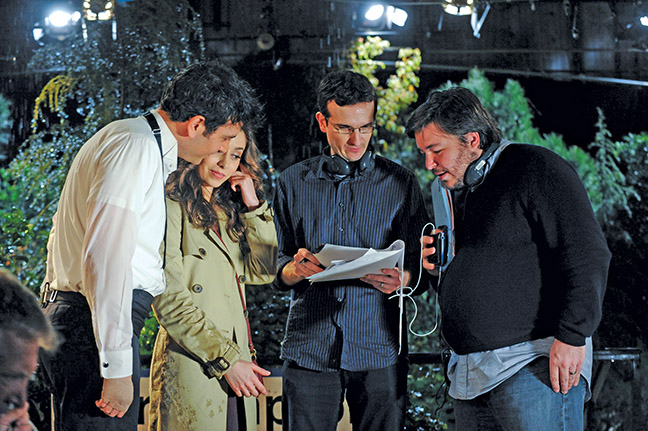 (L to R:) Josh Radnor as Ted, Cristin Milioti as Tracy, Craig Thomas, and Carter Bays on the set for the last episode of How I Met Your Mother.