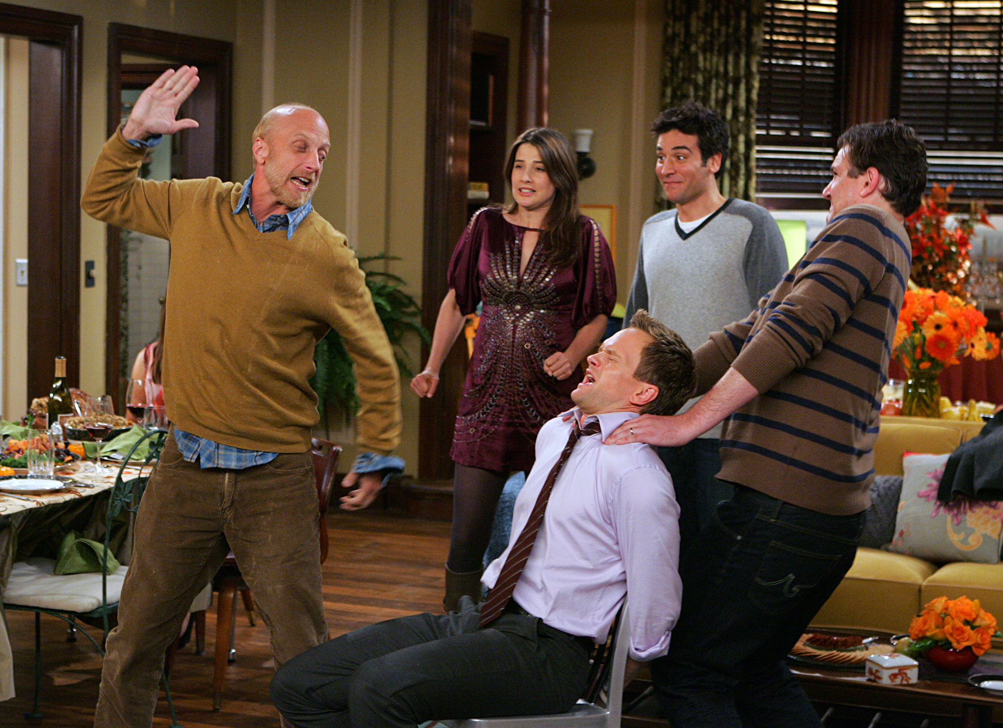 "Chris Elliott as Lily's father Mickey (left) with Cobie Smulders as Robin, Josh Radnor as Ted, Neil Patrick Harris as Barney, and Jason Segel as Marshall. ""Slapsgiving 2: Revenge of the Slap,"" Season 5, Episode 9 of How I Met Your Mother. Photo: Monty Brinton/CBS © 2009 CBS Broadcasting Inc. All Rights Reserved."