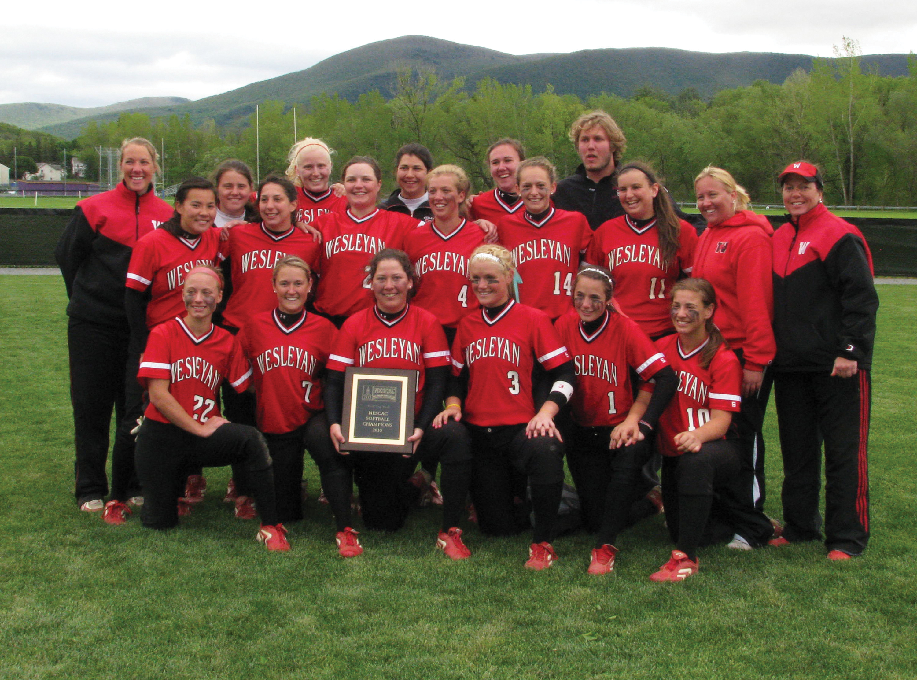 On the field at tournament host Williams College following their 10-1 triumph over Bowdoin, the 2010 Wesleyan softball team celebrated its NESCAC title by proudly displaying the championship plaque.