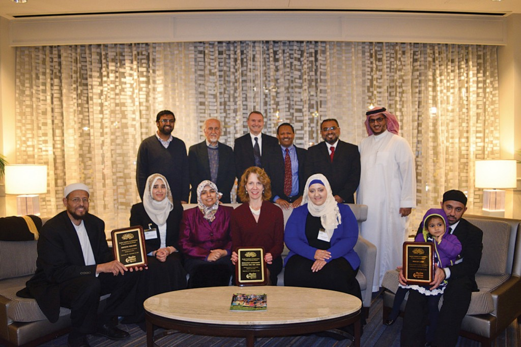 "The Muslim Coalition of Connecticut selected Wesleyan's Center for the Arts (CFA) as one of three honorees. Director of the CFA Pamela Tatge '84, MALS '10, P'16 (center) accepted on behalf of the university. Imam Zaid Shakir (left) from Zaytuna College and Imam Khalid Latif (right) from New York University were also selected as those ""bridging cultural gaps."" Photo: Muslim Coalition of Connecticut."