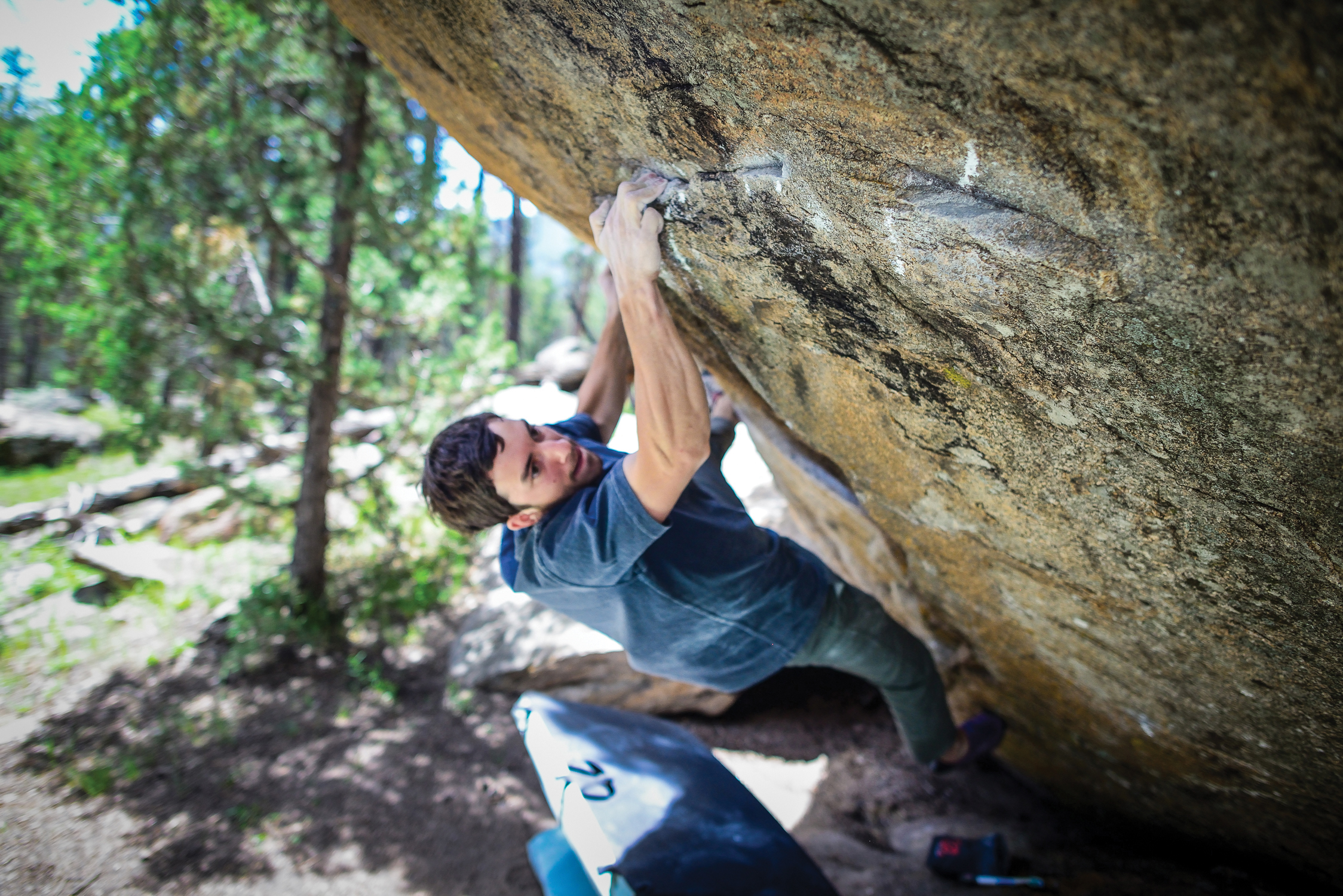 Tyler Landman '13, a world-class climber, finds bouldering a creative problem-solving process that taught him a scientific way of thinking.
