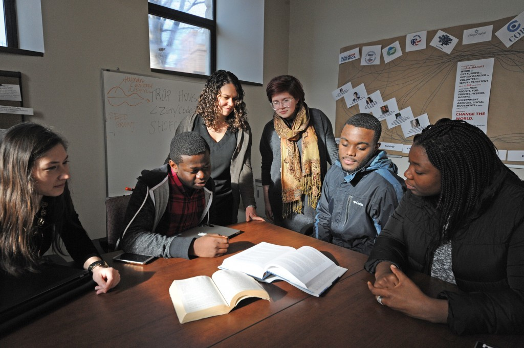 Makaela Kingsley (3rd from left) with student social entrepreneurs: Tiffany Coons '16, Alvin Chitena '19, Sara Eismont '18, Fritzgi Dessources '18, and Gerpha Gerlin '16. Photo by Cynthia Rockwell.