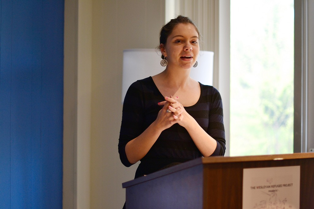 "Event organizer Sophie Zinser '16, a College of Letters and French studies major and student fellow for the Center for the Humanities, made connections with the Amal Foundation in December 2015. The organization supports refugees and their host communities by offering them access to education. ""I had no idea that months later [Amal and the Wesleyan Refugee Project] would be planning a show together, bringing art from Za'atari here to Wesleyan. We have made it our mission to represent these artists as if they could actually be at Wesleyan,"" Zinser said. Photo: Olivia Drake MALS '08"