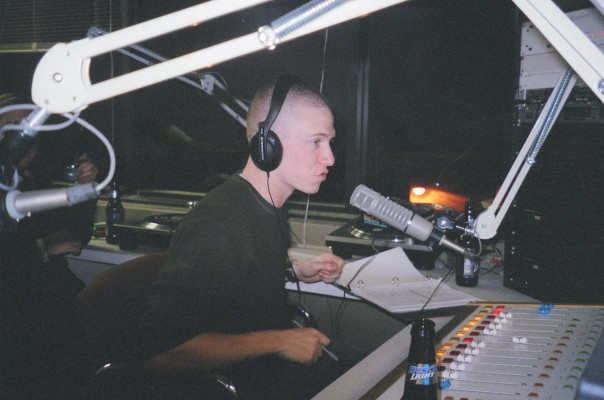 Jesse Sommer at the mic in the WESU studio as an undergrad