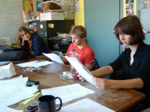 Students sit at the WESu station looking at their script