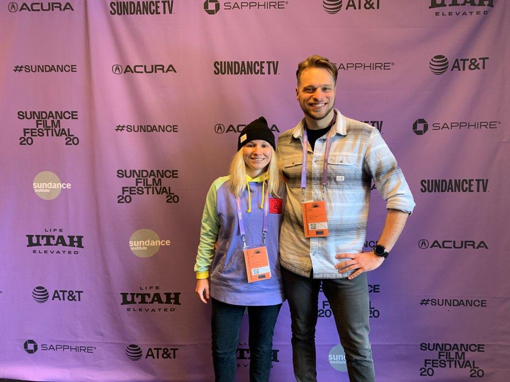 Ashley Brandon and Wesleyan Videographer Dennis Hohne pose in front of the screen for Sundance Film Festival.
