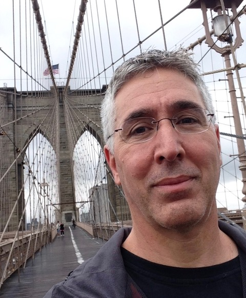 Dough Berman stands on a bridge.